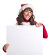 Weihnachtsfrau hinter Werbetafel