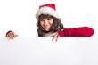 Weihnachtsfrau lehnt auf Schild