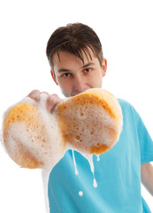 Child with soapy dripping sponge