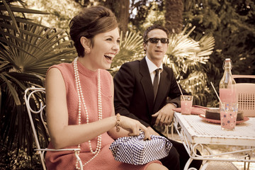 retro sixties style fashion couple having breakfast outdoor