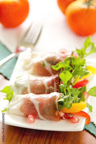 Smoked ham with vegetables and pomegranate
