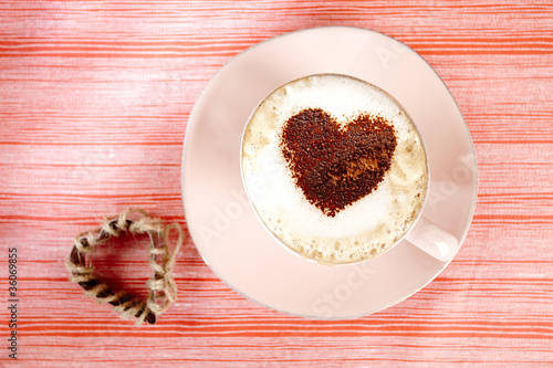 cappuccino with heart, red stripy backdrop