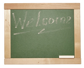 welcome written with a chalk on a blackboard