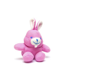 Pink toy rabbit on a white background