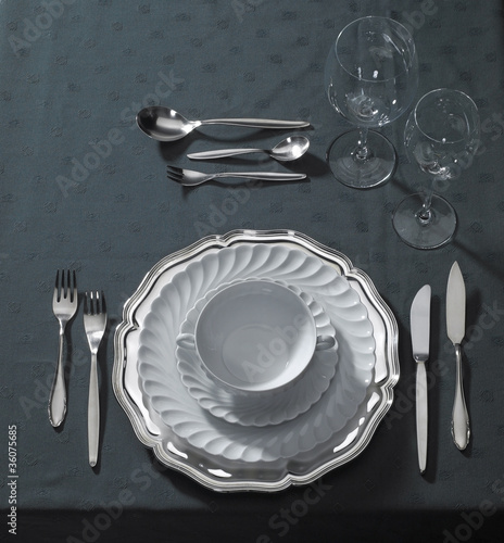 noble place setting on dark tablecloth