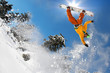 Snowboarder jumping against blue sky - 36077637