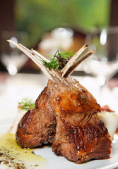 Raw rack of lamb fried with herbs and spices