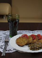 potato pancakes with mushrooms and cola