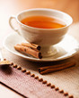 Cup of hot tea with cinnamon