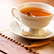 Cup of tea with cinnamon and brown sugar