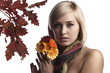 cute and pretty blonde wearing a scarf and holding some daisies