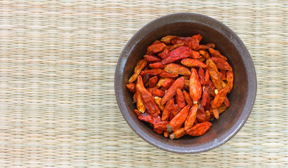 Hot dried chillies on white background
