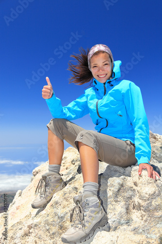 Hiker at mountain top summit