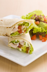 Two avocado wrap with a healthy side salad