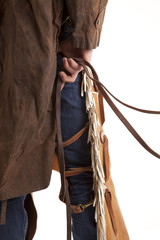Back of cowboy holding reins close