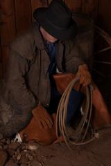 cowboy kneeling by barrel head down