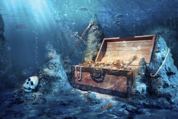 open treasure chest with bright gold underwater