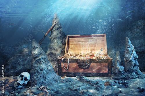 Leinwandbild Motiv open treasure chest with bright gold underwater