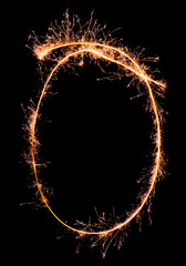 Digit 0 made of sparklers isolated on black