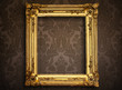 Leinwanddruck Bild - Empty golden painting frame on vintage wallpaper
