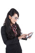 Businesswoman with glasses plays on her digital tablet