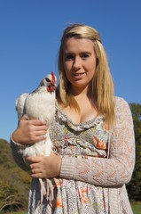 Girl Holding Sussex-Light Chicken