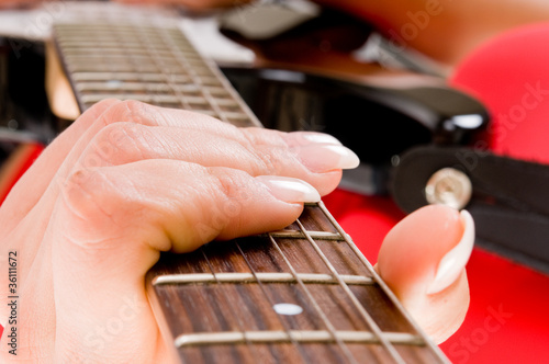 hands and fingers with a guitar