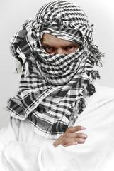 Stern arab muslim in shemagh kaffiyeh