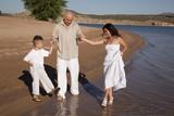 family wading on beach white poster