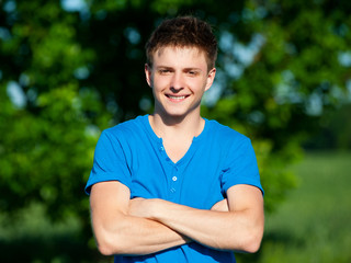 cheerful young man in blue t-shirt