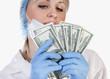 Doctor holding money