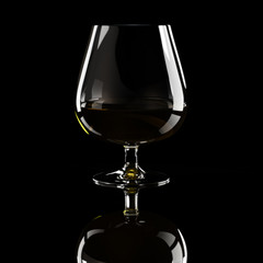 Glass of brandy over black