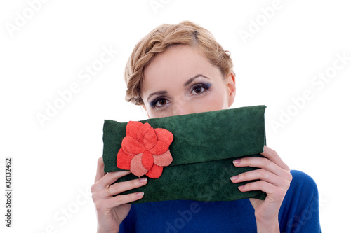 woman hidding her face with purse