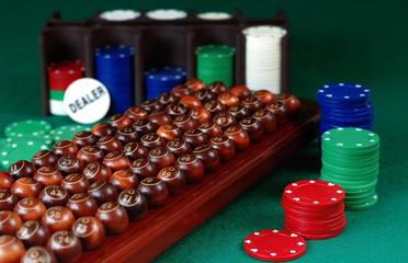 wooden bingo balls, stack of Poker chips and dealer button