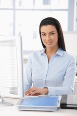 Portrait of happy office girl