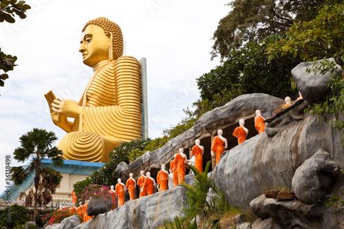 golden seated buddha in dambulla, sri lanka