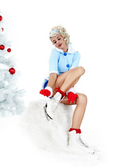 Pinup woman in winter style with skates. Isolated on white backg
