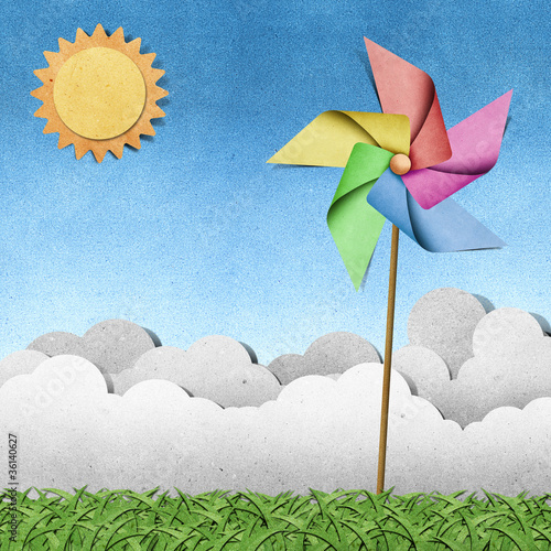 windmill on grass recycled papercraft  background