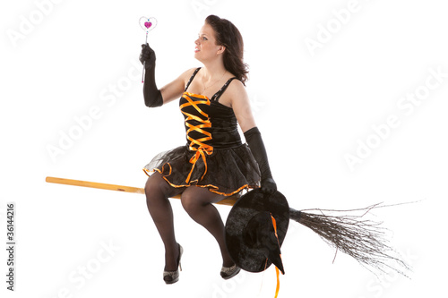 sexy girl in Halloween witch flying on a broom