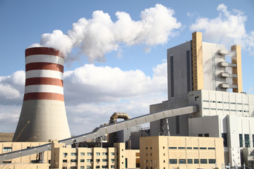 Power plant with smoking chimney