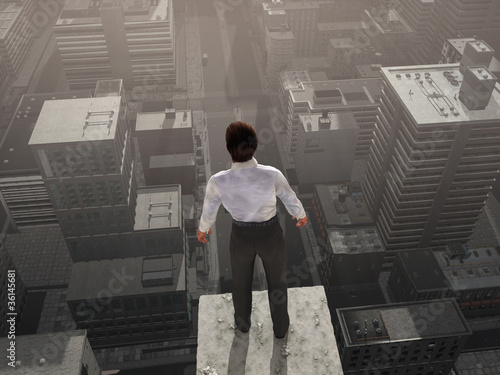 Businessman standing on the skyscraper top