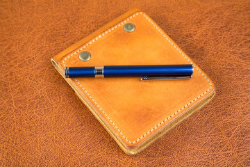 Leather organizers and fountain pen