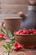 Fresh and dried rose hip on the table
