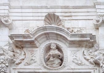 Baroque tympanum in Monopoli, Italy