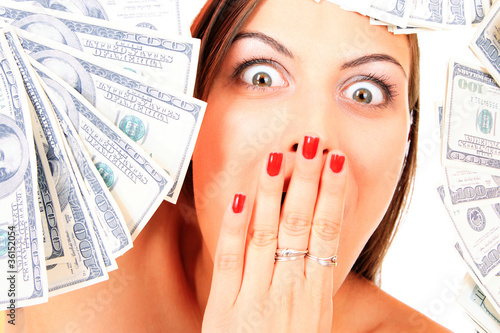 Young happy woman with dollar
