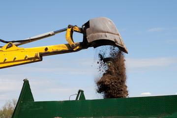 Excavator loading dumper truck