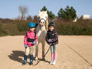 Two girls before training of horse riding