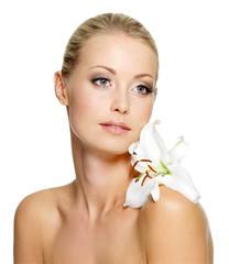 Beauty woman with perfect clean skin and flower