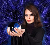 Girl with fortune telling ball against  star sky. poster