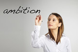 young business woman writing ambition word poster